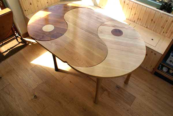 Yin Yang extendable table ash and oak with a walnut extension